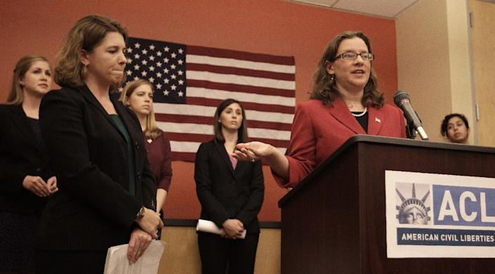 American Civil Liberties Union Women's Rights Project senior staff attorney Ariela Migdal, right, gestures while speaking beside ACLU attorney Elizabeth Gill, left, during a media conference Tuesday, Nov. 27, 2012, in San Francisco. Plaintiffs also present for the conference, background L-R, U.S. Army reserve Staff Sgt. Jennifer Hunt, U.S. Marine Corps reserve Capt. Zoe Bedell, and U.S. Marine Corps First Lt. Colleen Farrell. Several active women military personnel have filed a federal lawsuit to demand combat action, requesting all branches of the military to remove the so-called combat exclusionary rule that bars women from fighting on the front lines. This suit, to be filed by the American Civil Liberties Union, is believed to be the first involving active duty military personnel. (AP Photo/Ben Margot)