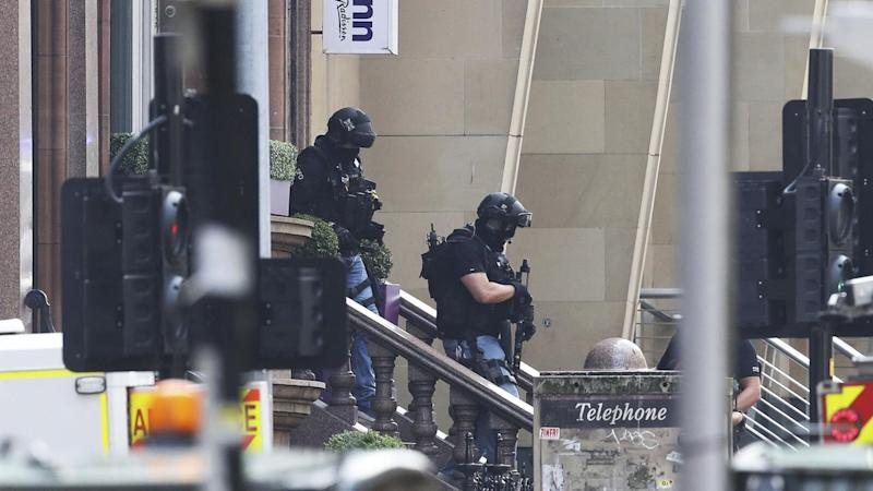 Police have shot dead a man who stabbed six people at a hotel in Glasgow, Scotland