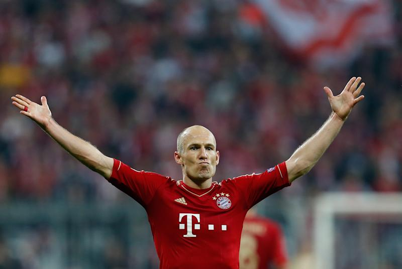 Bayern's Arjen Roben, from the Netherlands, celebrates after scoring their third goal during the Champions League semifinal first leg soccer match between Bayern Munich and FC Barcelona in Munich, Germany, Tuesday, April 23, 2013. (AP Photo/Matthias Schrader)