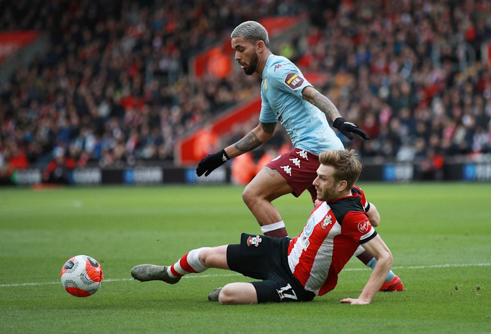 Aston Villa's Douglas Luiz in action with Southampton's Stuart Armstrong.