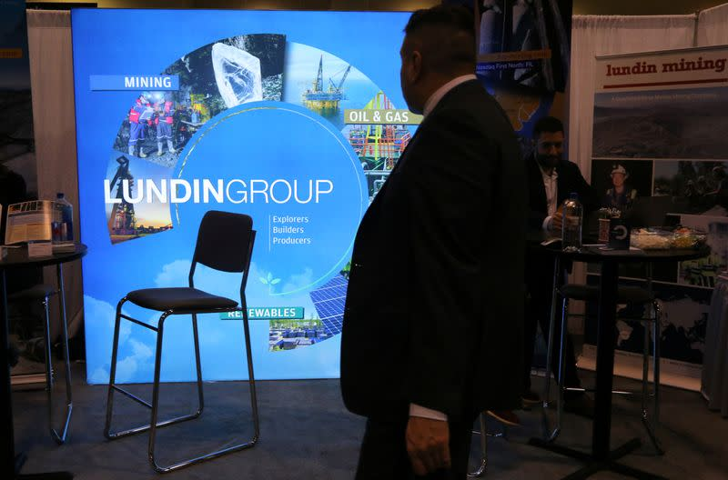 A man passes the Lundin Group mining company booth during the PDAC convention in Toronto