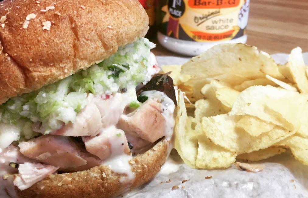 """<p>Though just about everything on the menu at pitmaster Chris Lilly's temple of barbecue looks outstanding, the real claim to fame at Big Bob Gibson Bar-B-Q is the smoked chicken, dunked into tangy mayo-based Alabama white sauce. That's right — mayo-based white sauce. It's one of those <a href=""""https://www.thedailymeal.com/eat/every-regional-barbecue-style-explained?referrer=yahoo&category=beauty_food&include_utm=1&utm_medium=referral&utm_source=yahoo&utm_campaign=feed"""">regional barbecue styles you need to try</a>. When the sauced-up chicken is tucked into a soft bun with bacon, lettuce, tomatoes, spicy pickles and honey mustard, it makes for one of the best chicken sandwiches you'll find anywhere.</p>"""