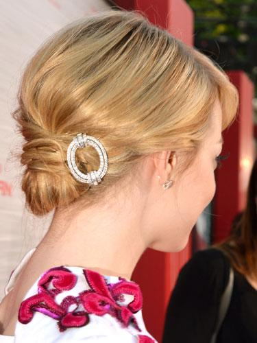 "<div class=""caption-credit""> Photo by: Getty Images</div><div class=""caption-title"">Emma Stone</div>""The diamond hair pin really finishes her undo,"" says Palacios of Stone's low bun. For your own, make a side part and divide a loose ponytail into two sections. Tuck the left section underneath, pinning it into place. Then, move the other section from right to left, tucking and pinning into place. Attach a decorative clip to the side of the updo. <br> <b><br></b><b>More from REDBOOK:</b> <br> <ul>  <li>  <a rel=""nofollow"" target="""" href=""http://www.redbookmag.com/beauty-fashion/tips-advice/winter-accessories?link=rel&dom=yah_life&src=syn&con=blog_redbook&mag=rbk""><b>100 Cute, Affordable Winter Accessories</b></a>  </li>  <li>  <a rel=""nofollow"" target="""" href=""http://www.redbookmag.com/beauty-fashion/tips-advice/celebrity-makeup-looks?link=rel&dom=yah_life&src=syn&con=blog_redbook&mag=rbk""><b>The 50 Most Iconic Beauty Looks of All Time</b></a>  </li> </ul>"