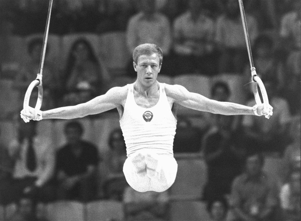 FILE - A Thursday July 24, 1980 photo from files of Nikolai Andrianov of the Soviet Union working with the rings in the men's gymnastics in Moscow Olympics.  Andrianov captured the silver medal in the event as the gold was won by teammate Alexandr Distyatin. Nikolai Andrianov, whose 15 Olympic medals made him the games' second-most-decorated man, has died at age 58. The International Gymnastics Federation said he died Monday, March 21, 2011, in his hometown of Vladimir, 200 kilometers (120 miles) east of Moscow. Russian news reports said Andrianov had suffered for years from the degenerative neurological disorder called multiple system atrophy. (AP Photo/File)