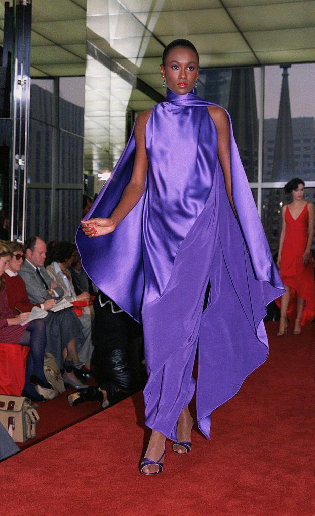 This sleeveless gown with wrap in blue is one of the designs modeled at Halston's spring-summer collection.