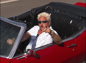 """<p>Guy's red convertible Chevy Camaro makes an appearance in every episode, but the car, which is worth more than $100,000, is off-limits to everyone on set—even Guy! The host <a href=""""https://www.insider.com/diners-drive-ins-and-dives-trivia-2018-12#fieri-invites-make-a-wish-families-to-every-taping-of-triple-d-12"""" rel=""""nofollow noopener"""" target=""""_blank"""" data-ylk=""""slk:doesn't drive the car"""" class=""""link rapid-noclick-resp"""">doesn't drive the car</a> to locations, it's shipped in a trailer and he's only filmed opening and closing the car door.</p>"""