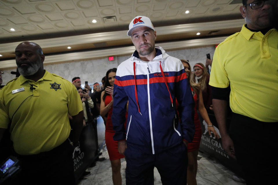 Sergey Kovalev walks through the crowd during a ceremonial arrival for an upcoming boxing match. Tuesday, Oct. 29, 2019, in Las Vegas. Kovalev is scheduled to fight Canelo Alvarez in a WBO light heavyweight title bout Saturday in Las Vegas. (AP Photo/John Locher)