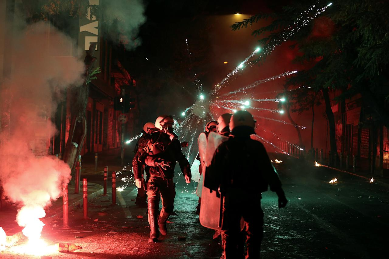 Fireworks explode next to riot police during clashes following an anniversary rally marking the 2008 police shooting of 15-year-old student, Alexandros Grigoropoulos, in Athens, Greece, December 6, 2016. REUTERS/Alkis Konstantinidis     TPX IMAGES OF THE DAY