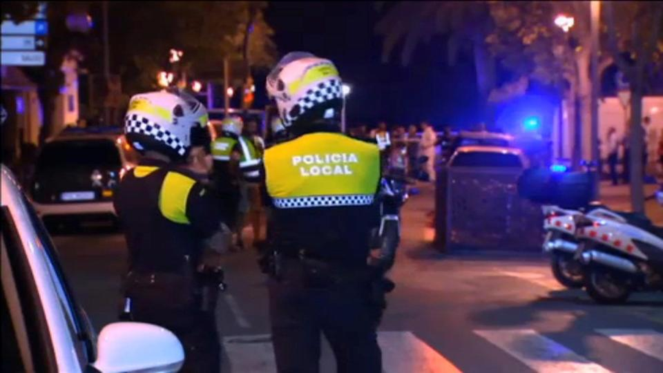 Officers investigate at the scene where police had killed five attackers in Cambrils, south of Barcelona. (Still image from Reuters video)