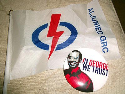 Some of the merchandise promoting Foreign Minister George Yeo and his PAP team standing for Aljunied GRC. (Yahoo! photo / Fann Sim)