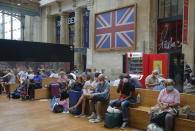 Passengers wait next to the Eurostar Terminal at the Gare du Nord train station in Paris, Friday, Aug. 14, 2020. British holidaymakers in France were mulling whether to return home early Friday to avoid having to self-isolate for 14 days following the U.K. government's decision to reimpose quarantine restrictions on France amid a recent pick-up in coronavirus infections. (AP Photo/Michel Euler)
