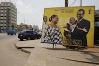 A poster campaigning for presidential candidate, Pascal Irenee Koupaki, is seen erected in the Akpakpa district in Cotonou, Benin March 4, 2016. REUTERS/Akintunde Akinleye