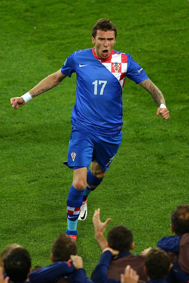 POZNAN, POLAND - JUNE 10: Mario Mandzukic of Croatia celebrates scoring their third goal during the UEFA EURO 2012 group C between Ireland and Croatia at The Municipal Stadium on June 10, 2012 in Poznan, Poland. (Photo by Clive Mason/Getty Images)