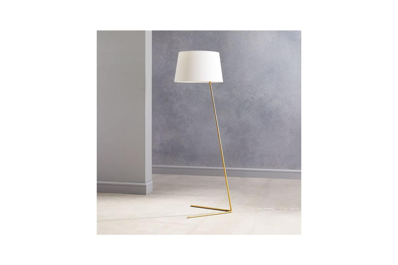 """Like Christine and the Queens, this lamp just can't help it that it's <a href=""""https://www.youtube.com/watch?v=9RBzsjga73s"""">tilted</a>. $300, West Elm. <a href=""""https://www.westelm.com/products/angled-outline-floor-lamps-w3465/?pkey=csale-lighting&isx=0.0"""">Get it now!</a>"""