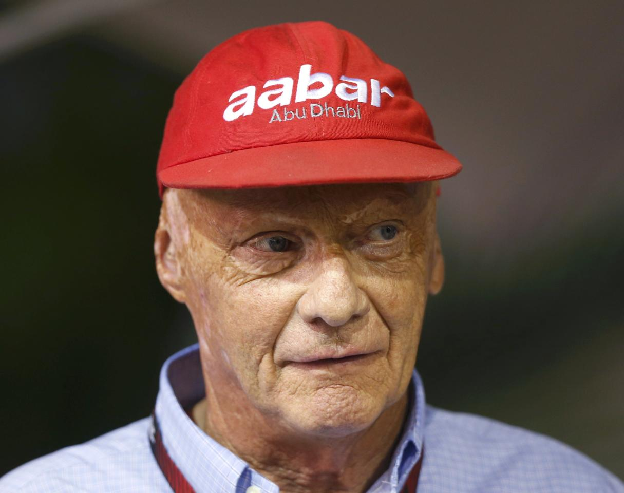 Former Formula One racing driver and three-time F1 World Champion Niki Lauda of Austria looks on in the Red Bull garage during the Singapore F1 Grand Prix at the Marina Bay street circuit in Singapore September 21, 2013. REUTERS/Pablo Sanchez (SINGAPORE - Tags: SPORT MOTORSPORT SPORT MOTORSPORT F1 HEADSHOT)