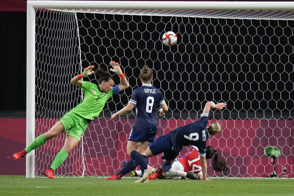 Britain's Ellen White (9) scores her side's opening goal against Chile during a women's soccer match at the 2020 Summer Olympics, Wednesday, July 21, 2021, in Sapporo, Japan. (AP Photo/Silvia Izquierdo)