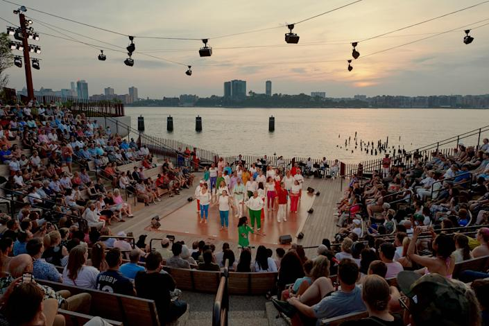 Broadway Inspirational Voices performs at the amphitheater on Little Island, which floats over the Hudson River, in New York, June 20, 2021. (Vincent Tullo/The New York Times)