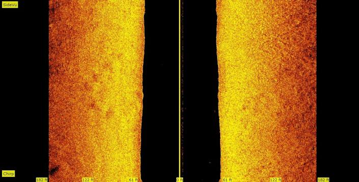 A side-scan sonar image of the Straits of Mackinac lake bottom, taken on Sept. 23, 2020, shows what appears to be stones in at least a half-circle, visible in the orange and yellow band on the left, about halfway down.  Side-scan sonar uses ultra-sonic waves bounced along a lake bottom to detect items on the sea floor. The group behind the Straits exploration believe this is evidence of rocks intentionally placed there by a culture at a time when the area would have been above-water -- around the end of the Ice Age some 10,000 years ago.