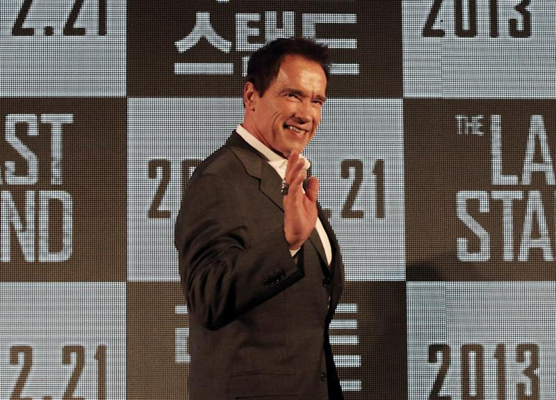 """Actor Arnold Schwarzenegger waves as he arrives to hold a press conference to promote his latest film """"The Last Stand"""" in Seoul, South Korea, Wednesday, Feb. 20, 2013. The movie will open on Thursday, Feb. 21, in South Korea. (AP Photo Ahn Young-joon)"""