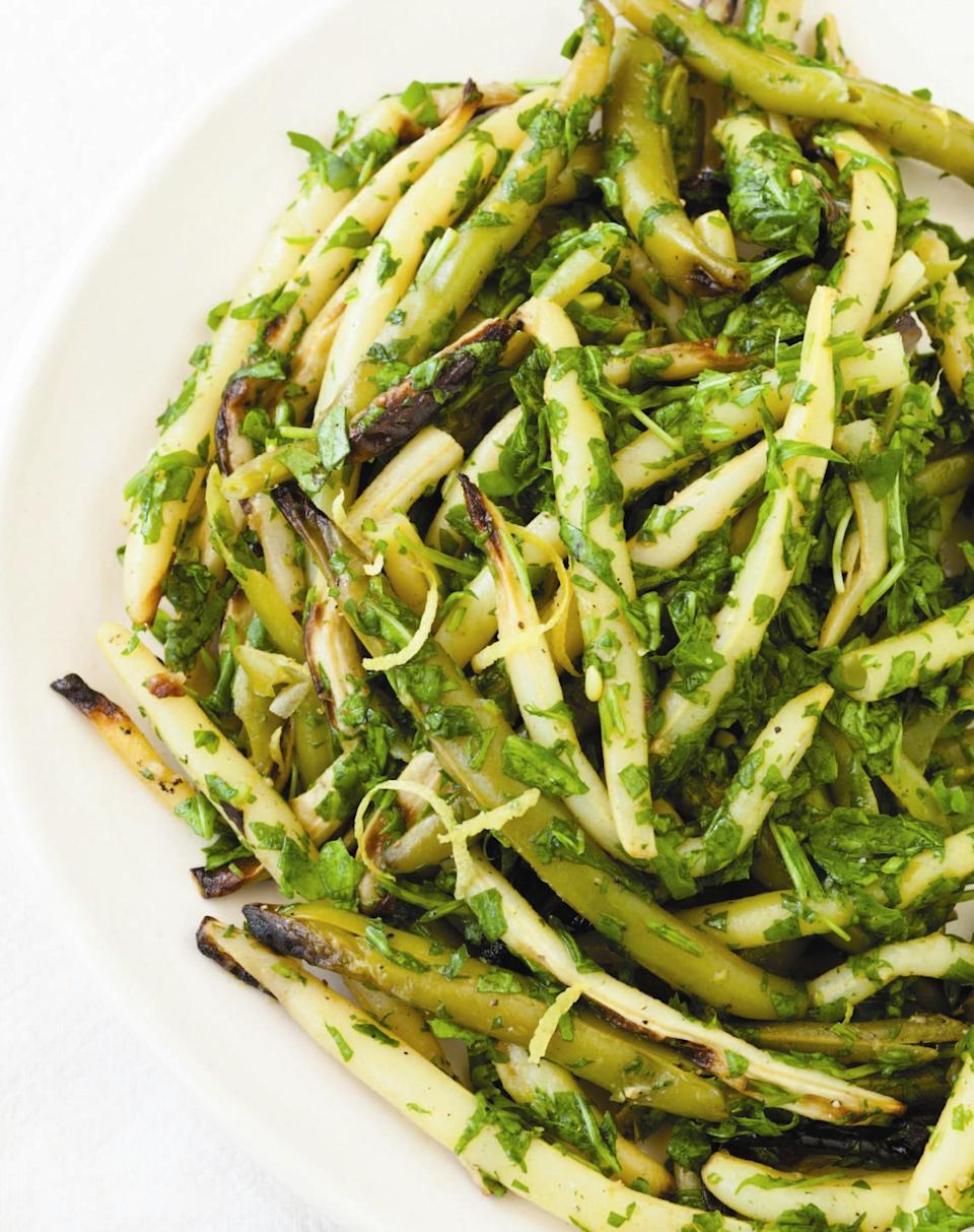 "Wilting the arugula with the hot, garlicky grilled beans is a nice way to unite the two vegetables. Baby arugula is milder in flavor than regular arugula, though either will work here. <a href=""https://www.epicurious.com/recipes/food/views/string-bean-arugula-salad-51100200?mbid=synd_yahoo_rss"" rel=""nofollow noopener"" target=""_blank"" data-ylk=""slk:See recipe."" class=""link rapid-noclick-resp"">See recipe.</a>"