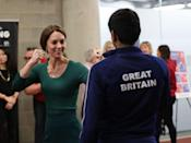 """<p>At the same event, Kate certainly packed a punch! She accessorized her look for the day with a necklace engraved with """"GCL""""—a tiny tribute to her three children: George, Charlotte, and Louis.</p>"""