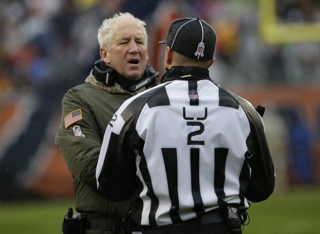 Chicago head coach John Fox argues a call with line judge Bart Longson during the Bears' 23-16 loss to the Green Bay Packers. (AP Photo)