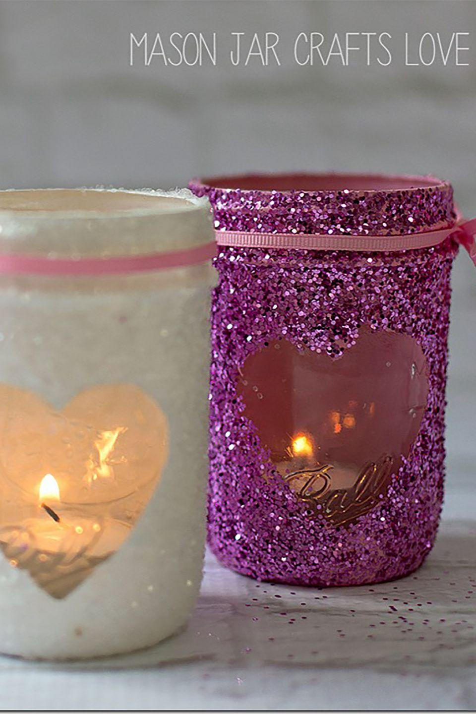 """<p>Spruce up your spare Mason jars with glitter to create the cutest candles for Valentine's Day.</p><p><strong>Get the tutorial at <a href=""""http://masonjarcraftslove.com/valentine-glitter-votives/"""" rel=""""nofollow noopener"""" target=""""_blank"""" data-ylk=""""slk:Mason Jar Craft Love"""" class=""""link rapid-noclick-resp"""">Mason Jar Craft Love</a>. </strong></p><p><strong><a class=""""link rapid-noclick-resp"""" href=""""https://www.amazon.com/s/ref=nb_sb_noss_2?url=search-alias%3Dgarden&field-keywords=mason+jars&tag=syn-yahoo-20&ascsubtag=%5Bartid%7C10050.g.2971%5Bsrc%7Cyahoo-us"""" rel=""""nofollow noopener"""" target=""""_blank"""" data-ylk=""""slk:SHOP MASON JARS"""">SHOP MASON JARS</a><br></strong></p>"""
