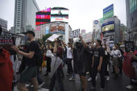 People march to protest during a solidarity rally for the death of George Floyd in Tokyo Sunday, June 14, 2020. Floyd died after being restrained by Minneapolis police officers on May 25. (AP Photo/Eugene Hoshiko)