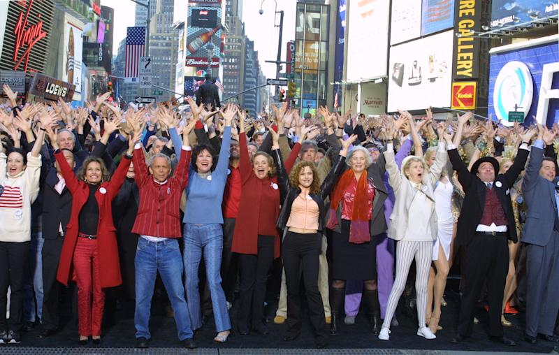 """FILE - This Sept. 28, 2001 file photo shows hundreds of Broadway cast members, including front row, from left, Bebe Neuwirth, Susan Lucci, Joel Grey, Michele Lee, Valeria Harper, Bernadette Peters, Betty Buckley, Elaine Stritch, Nathan Lane and Matthew Broderick. singing """"New York, New York"""" for a public service announcement shot in New York's Times Square. The Actors' Equity Association, which has begun a yearlong celebration of its centennial, will get a Special Tony in recognition of their work negotiating wages, working conditions and benefits for stage performers and crew members. (AP Photo/Diane Bondareff, file)"""