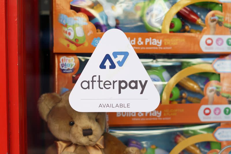FILE PHOTO: A logo for the company Afterpay is seen in a store window in Sydney
