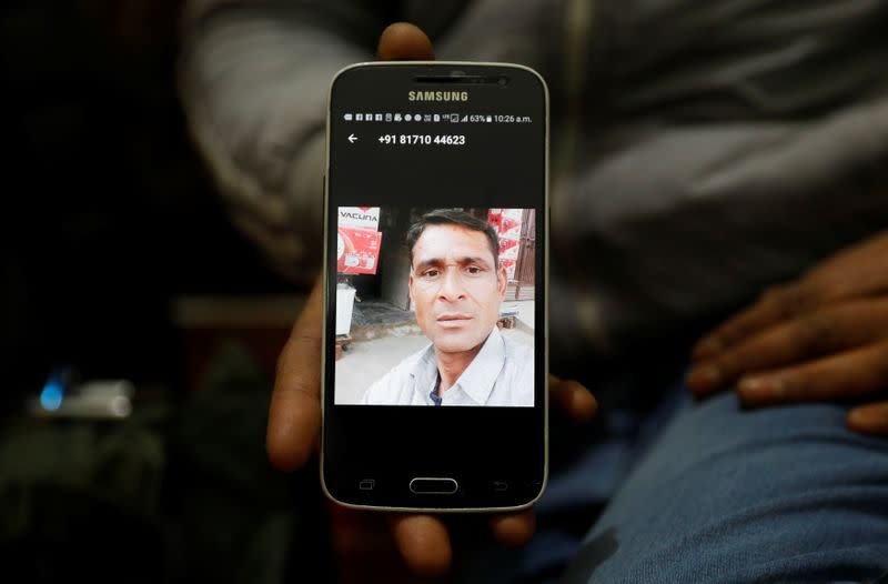 A relative shows a picture of Zaheer Ahmed, who died during clashes with police following protests against a new citizenship law, inside zaheer's house in Meerut