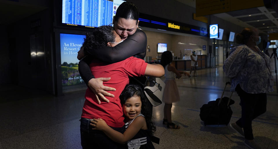 Emely and her mum were reunited in emotional scenes at a Texas airport. Source: AP