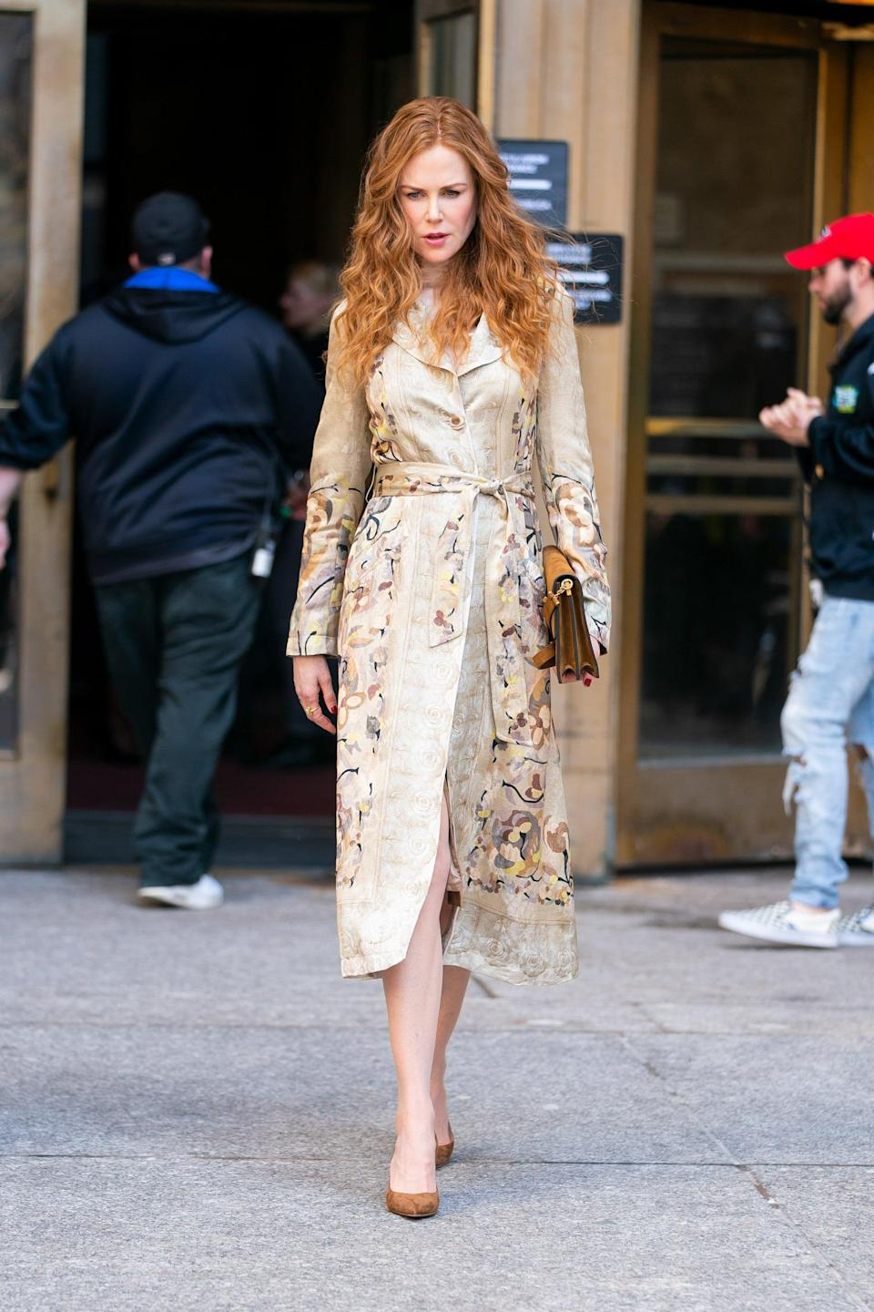 <p>This gorgeous embroidered Etro trench stands out among the sea of darker coats in Grace's collection. She wears it while heading to the court in episode five, likely to give off an air of innocence.</p>