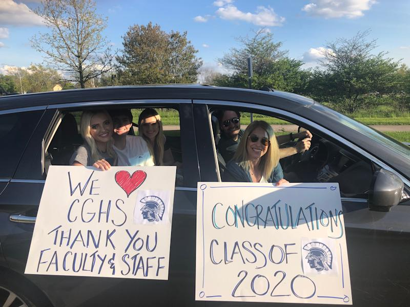 Class of 2020 graduate Annabelle Poppe (left), boyfriend, Michael, and sister, Faith, are paraded back through Cary-Grove High School by parents, Chris and Jen. (Eric Edholm/Yahoo Sports)