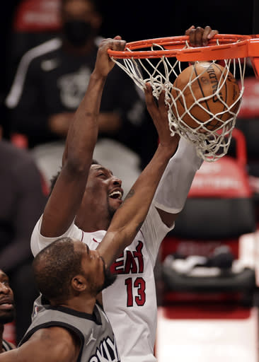 Miami Heat center Bam Adebayo (13) dunks over Brooklyn Nets forward Kevin Durant during the first half of an NBA basketball game Monday, Jan. 25, 2021, in New York. (AP Photo/Adam Hunger)