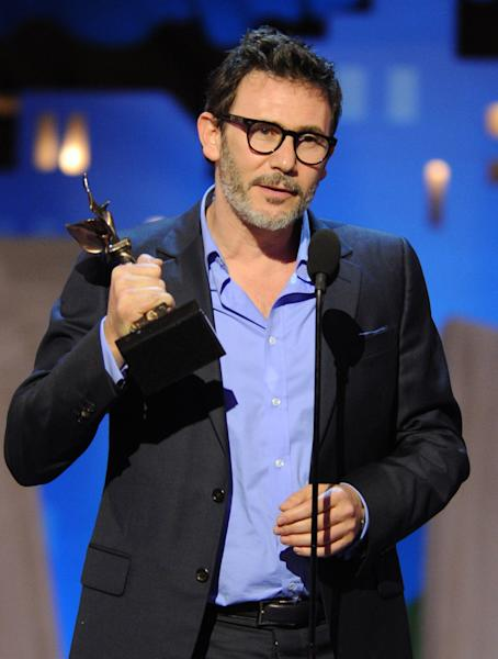 Michel Hazanavicius accept the best director award for The Artist at the Independent Spirit Awards on Saturday, Feb. 25, 2012, in Santa Monica, Calif. (AP Photo/Vince Bucci)