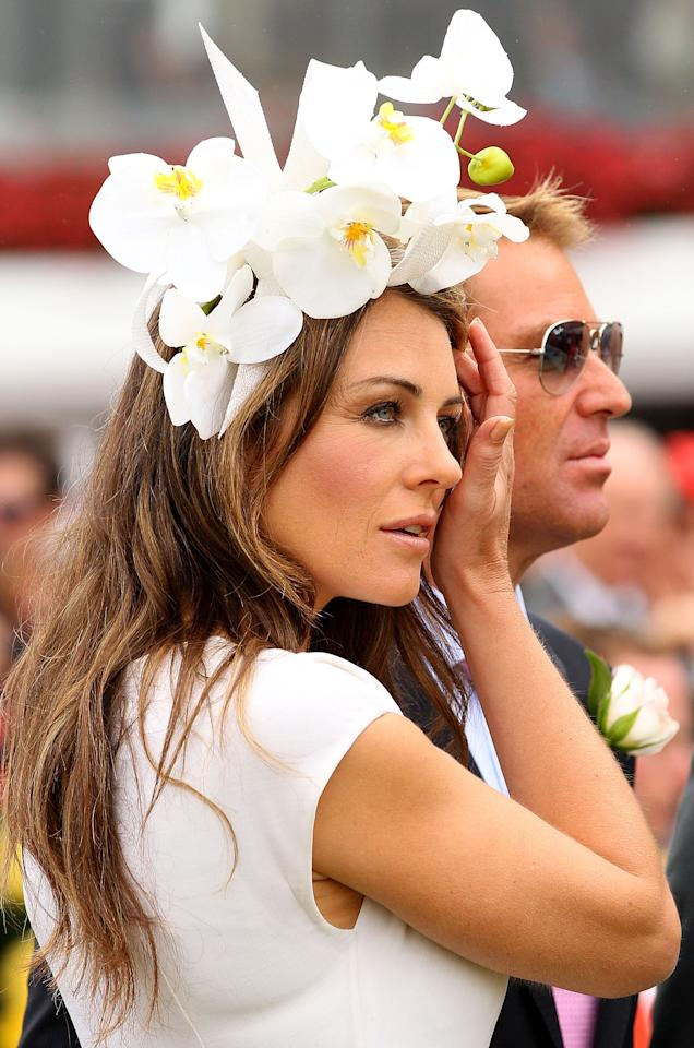 MELBOURNE, AUSTRALIA - NOVEMBER 03:  Shane Warne and Elizabeth Hurley attend the presentation of the Crown Oaks during Crown Oaks Day at  Flemington Racecourse on November 3, 2011 in Melbourne, Australia.  (Photo by Lucas Dawson/Getty Images)
