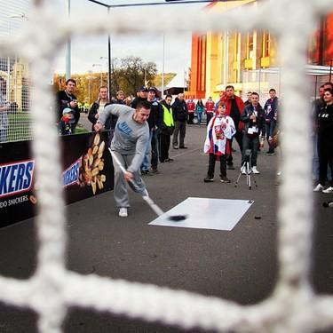 Fan takes slapshot outside Tipsport Arena in Prague. (#NickInEurope)