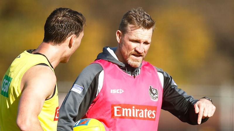 Pictured here, Collingwood coach Nathan Buckley at Magpies training.