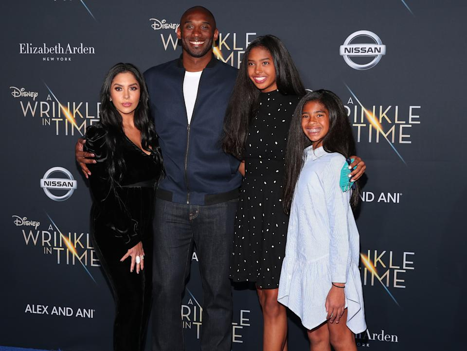 Kobe Bryant with his family, including sisters Natalia and Gianna, in Feb. 2018 in Los Angeles. (Photo: Christopher Polk/Getty Images)