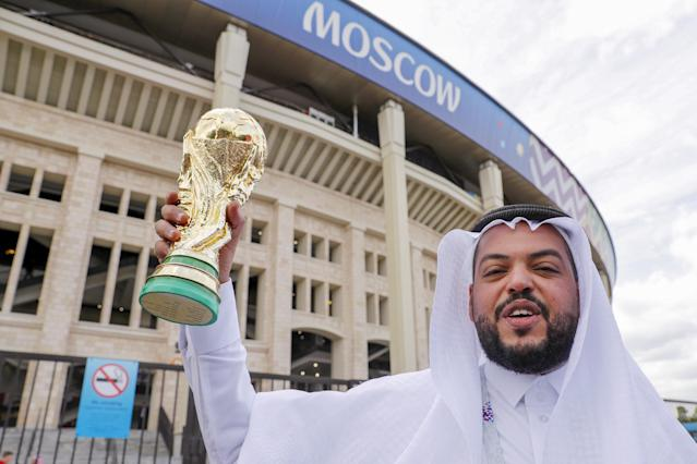 <p>Up for the Cup: A Saudi Arabia fan with a replica World Cup trophy at the Luzhniki Stadium. (PA) </p>