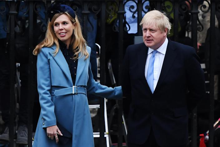 Boris Johnson and his fiancée Carrie Symonds leave the Commonwealth Day Service 2020 at Westminster Abbey, London, on 9 March. (Getty Images)
