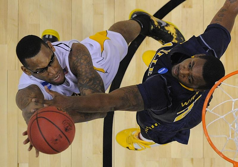 Wichita State's Carl Hall, left, and La Salle's Jerrell Wright battle under the basket during the first half of a West Regional semifinal in the NCAA college basketball tournament, Thursday, March 28, 2013, in Los Angeles. (AP Photo/Mark J. Terrill)