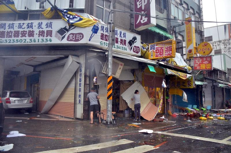 Debris is seen in front of a shop with broken shutters, towrn away by strong winds of Super Typhoon Nepartak, in Taitung, Taiwan, on July 8, 2016 (AFP Photo/-)