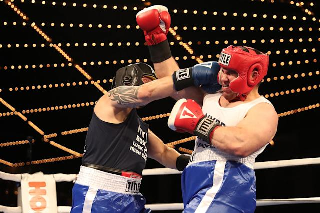 <p>New York's Finest Dom Nasso, left, and Elwin Martinez mix it up in the ring during the NYPD Boxing Championships at the Theater at Madison Square Garden on June 8, 2017. (Photo: Gordon Donovan/Yahoo News) </p>
