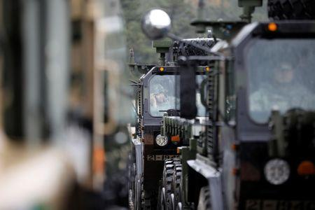 A U.S. Army soldier sits inside their military vehicle as he takes part in Operation Pacific Reach joint logistic exercise in Pohang