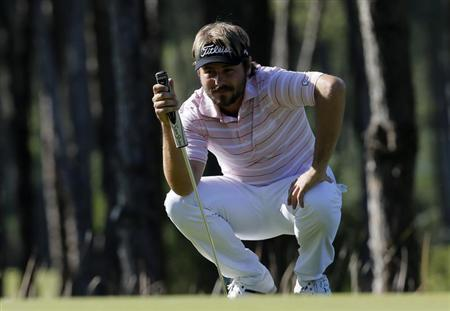 Dubuisson of France looks at his putt on the fifth green during the final round of the Turkish Airlines Open in Antalya