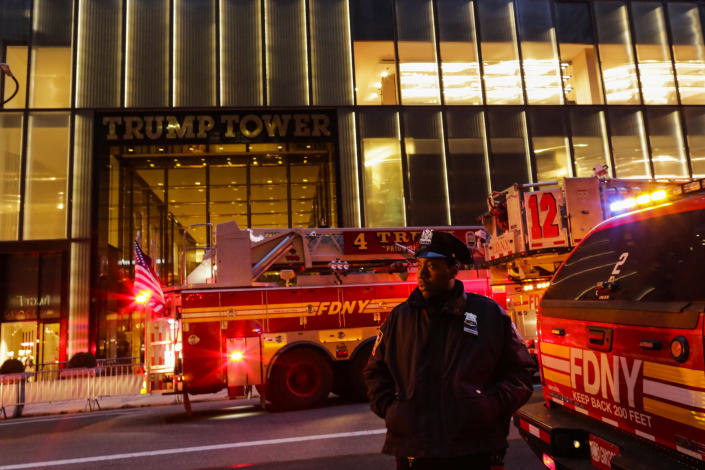<p>NYPD officers and first responders asses the scene of a fire at Trump Tower on April 7, 2018 in New York City. One person has reportedly died and four firefighters were injured in the four-alarm blaze which broke out on the 50th floor. (Photo: Eduardo Munoz Alvarez/Getty Images) </p>