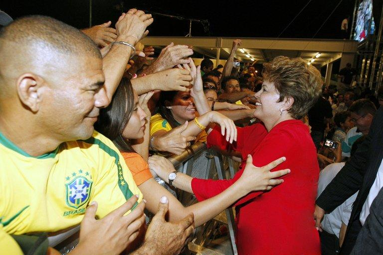 Brazilian President Dilma Rousseff greeting supporters at the Castelao stadium in Fortaleza on December 16, 2012