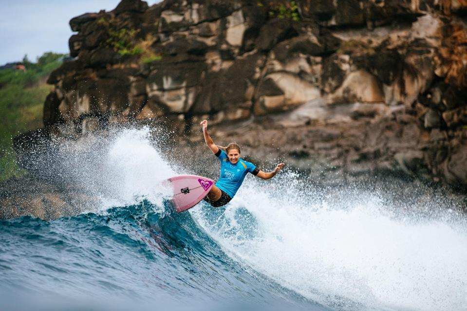 """<p><strong>Sport:</strong> Surfing<br> <strong>Country:</strong> Australia</p> <p>It'll be surfing's first year in the Olympics and expectations are high, especially for living legends like Gilmore. A <a href=""""https://www.worldsurfleague.com/athletes/389/stephanie-gilmore"""" class=""""link rapid-noclick-resp"""" rel=""""nofollow noopener"""" target=""""_blank"""" data-ylk=""""slk:seven-time world champion"""">seven-time world champion</a> (tied with Layne Beachley for the most women's titles of all time), Gilmore was the first surfer to win a world title in her rookie season, back in 2007. Now 32, she continues to dominate pro surfing and finished the 2020 season ranked No. 4 in the world, the top-ranked Australian going into Tokyo. Watching the 2000 Olympics in Sydney as a 12-year-old caused Gilmore to <a href=""""https://www.popsugar.com/fitness/surfer-stephanie-gilmore-2020-olympics-interview-47202004"""" class=""""link rapid-noclick-resp"""" rel=""""nofollow noopener"""" target=""""_blank"""" data-ylk=""""slk:fall in love with the idea of going to the Olympics"""">fall in love with the idea of going to the Olympics</a>, she told POPSUGAR in February. """"I never thought I'd get the chance as a surfer, but here we are, and it's like a dream come true."""" Gilmore <a href=""""https://www.popsugar.com/fitness/surfers-carissa-moore-caroline-marks-make-us-olympic-team-46965372"""" class=""""link rapid-noclick-resp"""" rel=""""nofollow noopener"""" target=""""_blank"""" data-ylk=""""slk:beat the current world champion"""">beat the current world champion</a>, Carissa Moore, at the last competition of 2019, and she's a fierce competitor who could make a major play for gold.</p>"""